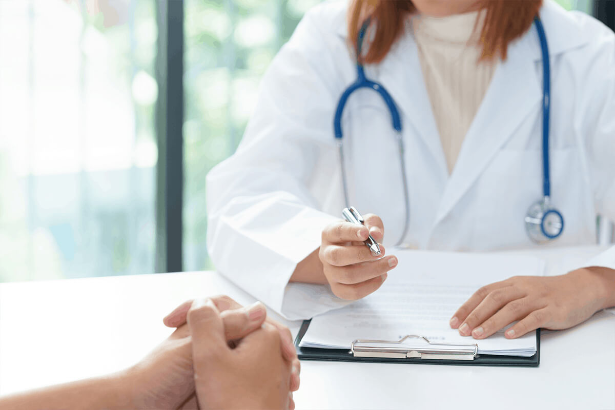 Caring doctor talking to patient